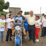 Alvaro Noboa with Jorge Santos and his New Tricycle will be his new tool