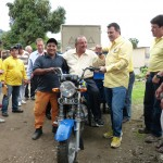 Alvaro Noboa with Jorge Santos while making a delivery of a Tricycle