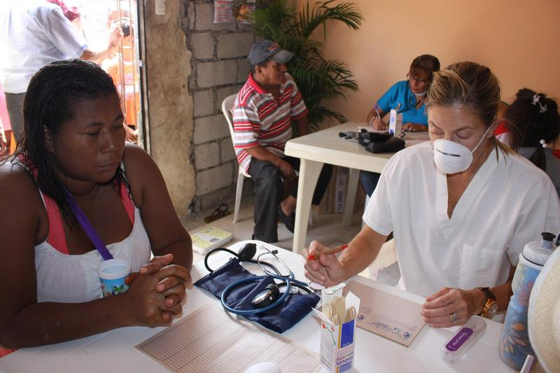 Annabella Azin provides medical care to the members of the Esmeraldas Chiquito community.