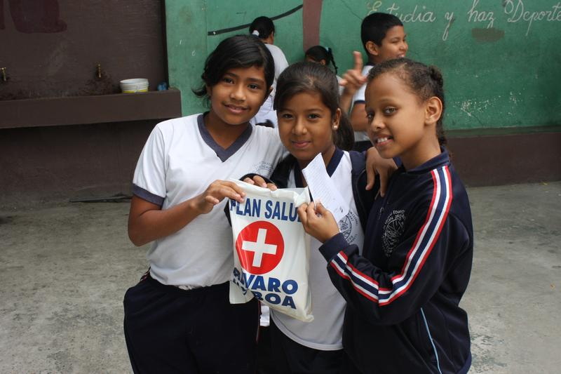 Students from Kairos Academy receive medical care from FCNH